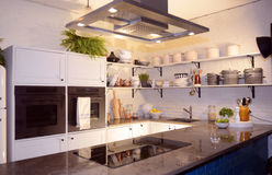 Beautiful Modern White Kitchen with Stone Counters Royalty Free Stock Photos