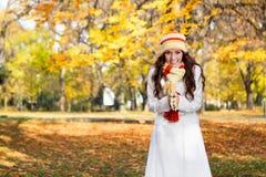 Beautiful modern woman in autumn park stock photo