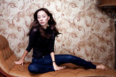 Free Beautiful Modern Woman Sitting On Vintage Couch Royalty Free Stock Photography - 35541377