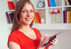 Modern woman using the tablet pc Royalty Free Stock Photo