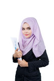 Beautiful modern Young Asian Muslim business woman holding reports Royalty Free Stock Photography