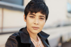 Beautiful modern young woman with short hair royalty free stock photo