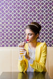Beautiful modern young woman sitting at the table Royalty Free Stock Photography