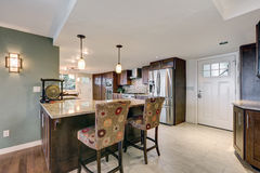 Beautiful modernized epicurean kitchen. With natural brown cabinets, granite countertops and mosaic backsplash. Northwest, USA Stock Photography