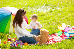 Beautiful Mom and baby outdoors. Happy family playing in nature. Stock Photo