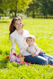 Beautiful Mom and baby outdoors. Happy family playing in nature. Royalty Free Stock Image