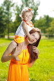 Beautiful Mom and baby outdoors. Happy family playing in nature. Royalty Free Stock Photos