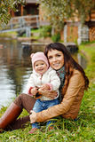 Beautiful mom brunette holding a charming beautiful little girl royalty free stock photo