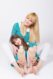 Beautiful mom and daughter hugging and smiling stock photography