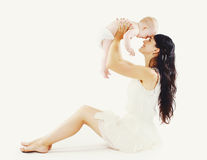 Beautiful mom with her cute baby having fun Stock Photography