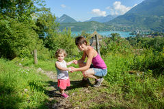 A beautiful mom and her little girl on the hiking trail Royalty Free Stock Photo