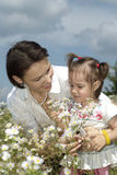 Beautiful mom holding her daughter Royalty Free Stock Images