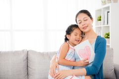 Beautiful mom holding lovely little daughter hug Stock Photo