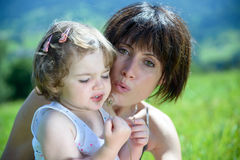 A beautiful mom is a hug to her daughter Royalty Free Stock Photo