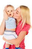 Beautiful mom hugs baby Stock Images