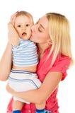 Beautiful mom hugs baby. Isolated on white background Stock Images