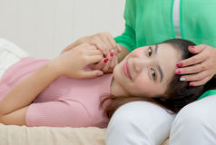 Beautiful Mom And teenage daughter spend time together at home ,. Mother`s day Royalty Free Stock Photo