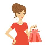 Beautiful mom to be holding dress Royalty Free Stock Photo
