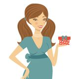 Beautiful mom to be holding gift box Royalty Free Stock Photos