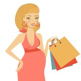 Beautiful mom to be holding shopping bags Royalty Free Stock Photos