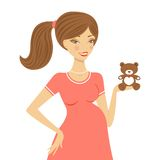 Beautiful mom to be holding teddy bear Stock Images