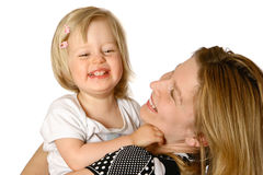 Beautiful mom and toddler. Girl playing tickle together, isolated on white Royalty Free Stock Photos