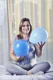 Beautiful mommy celebrate with balloons her unborn baby boy Stock Photos