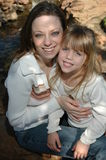 Beautiful moms and daughters stock images
