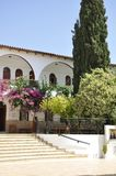 Monastery Panagyia Kaliviani courtyard building entrance from Mires in Crete island of Greece. Beautiful Monastery Panagyia Kaliviani courtyard building entrance stock images