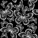 Beautiful monochrome black and white seamless background with flying butterflies. Royalty Free Stock Photography