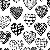 Beautiful monochrome, black and white seamless background hand drawn hearts. Royalty Free Stock Images