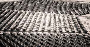 A beautiful monochrome pattern of wooden benches Royalty Free Stock Photo