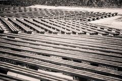 A beautiful monochrome pattern of wooden benches Stock Photo