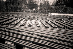 A beautiful monochrome pattern of wooden benches Stock Photography