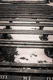 A beautiful monochrome pattern of wooden benches Royalty Free Stock Images