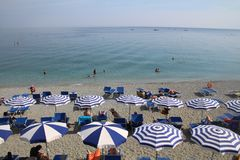 Beautiful Monterosso Beach sun lovers beach chairs and parasols , Cinque Terre stock image