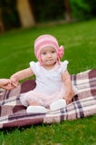 Beautiful 4 month old baby girl in pink flower hat and tutu Royalty Free Stock Photo