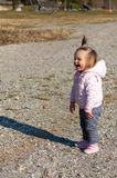 Standing. Laughing. Beach. Cute. Sand. Baby. Girl stock image
