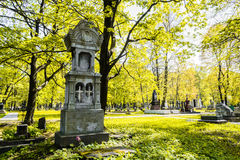 A beautiful monument in the cemetery. Old cemetery in the fall. Beautiful carved gravestone in the autumn cemetery. The monument is located in Saint-Petersburg Royalty Free Stock Photo