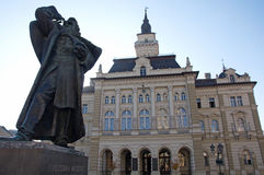 Beautiful monument to Svetozar Miletic, the first Serbian socialist and City Hall in Novi Sad Royalty Free Stock Images