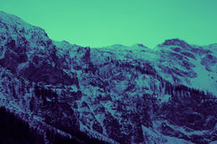 Beautiful moody frosty landscape European alpine mountains Royalty Free Stock Images
