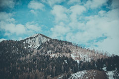 Beautiful moody frosty landscape European alpine mountains Stock Images