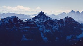 Beautiful moody mountains range view from Mt Temple, Banff, Rocky mountains, Canada. Beautiful moody mountains range view from Mt Temple, Banff, Rocky Mountains Royalty Free Stock Photo