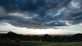 Beautiful dramatic Summer sunset landscape over English countrys. Beautiful moody Summer sunset landscape over English countryside with lovely light Royalty Free Stock Images