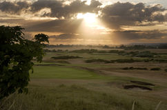 Beautiful moody sunset over golf course Stock Photography
