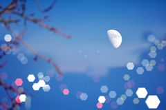 The beautiful moon at night is shining with fascinating brilliance. In Flushing, New York, the moon around 4 pm, the beautiful moon, sparkles with fascinating royalty free stock photos