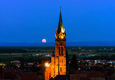 Beautiful moonrise over the church, Alsace Stock Images