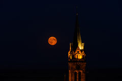 Beautiful moonrise over the church, Alsace Stock Photos