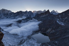 Beautiful moraine lake and snowy mountain peaks. Royalty Free Stock Images