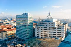 Beautiful morning above Ljubljana old city and business downtown skyscrapers. Beautiful moring above Ljubljana old city and business downtown center with royalty free stock image